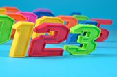 foto of blue things  - Colorful plastic numbers 123 close up on a blue background - JPG