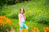 foto of pullovers  - Cute little girl playing in a park - JPG