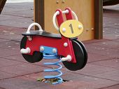 picture of bouncing  - A bouncing bike on a childrens playground  - JPG