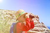 picture of binoculars  - little boy looking through binoculars while travel in mountains - JPG