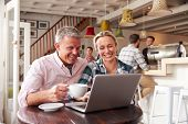 stock photo of cafe  - Couple meeting in a cafe - JPG