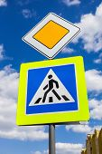 stock photo of pedestrian crossing  - Traffic signs main road and pedestrian crossing with clouds in background - JPG