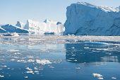 image of iceberg  - Beautiful Icebergs in Disko Bay Greenland around Ilulissat with blue sky - JPG