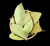 stock photo of bay leaf  - Bay leaves in wooden bowl - JPG
