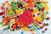 pic of candy  - Colorful candies on wooden background - JPG