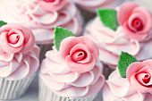 stock photo of sugarpaste  - Wedding cupcakes decorated with pink sugar roses - JPG