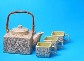 stock photo of ceremonial clothing  - Asian tea set served on a blue table cloth - JPG