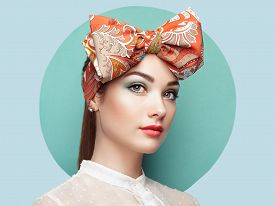 foto of bowing  - Portrait of beautiful young woman with bow - JPG