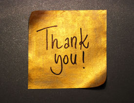 pic of thank you note  - thank you message handwritten on gold sticker isolated on gray background - JPG
