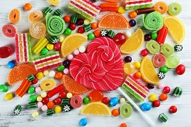 picture of bonbon  - Colorful candies on wooden background - JPG