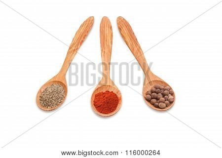 Different Kinds Of Pepper In Three Wooden Spoons