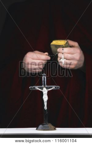 Mystery Monk's Hands With A Cape,  Bible,  A Black Rosary And Crucifix