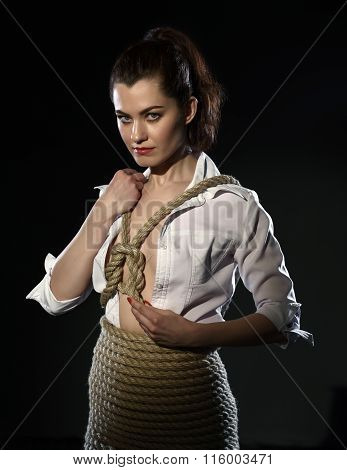 Shibari. Woman tied with rope in style of BDSM