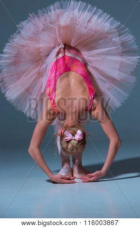 Ballerina in pink tutu  leaning forward