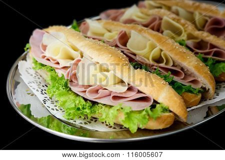 Cheese, ham and salad baguettes.