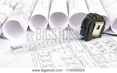 Tape measure on blueprint