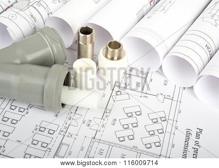 Plumbing fitting on blueprint
