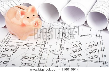 Piggy bank on blueprint