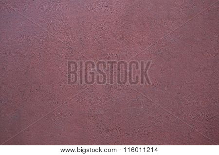 Burgundy red painted stucco wall. Background texture.