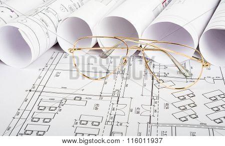 Glasses on blueprint