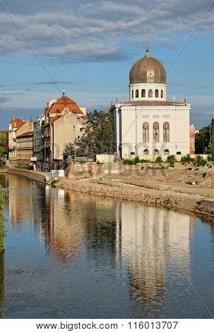 Neolog Synagogue Zion reflecttion on Crisul Repede River in Oradea, Romania