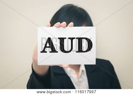 AUD message on the card Held by women.