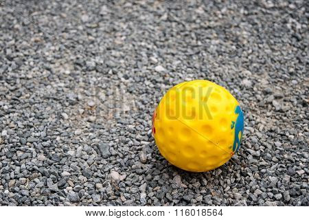 Yellow Ball Toy For Dog On Bedrock