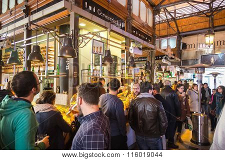 People drinking and eating at San Miguel market, Madrid.