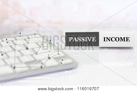 White label with keyboard on the table and text PASSIVE INCOME.
