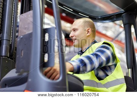 man operating forklift loader at warehouse