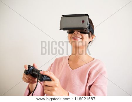Excited Young Woman play game with virtual reality device