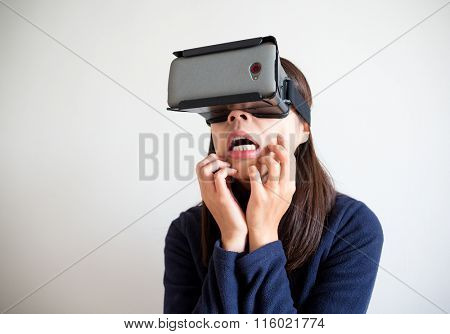 Woman looking though the virtual reality device and feeling scared