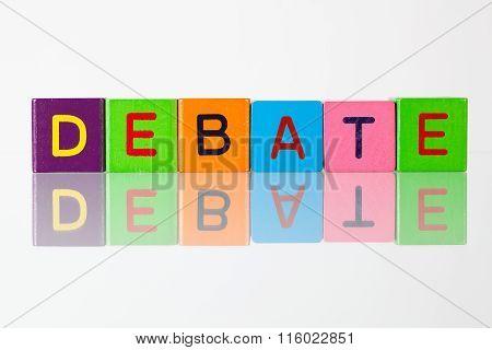 Debate - an inscription from children's wooden blocks