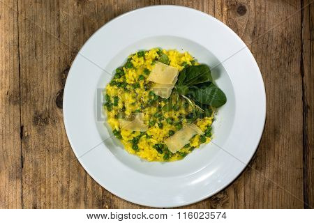 Leek, garden pea and saffron risotto looking down on plate