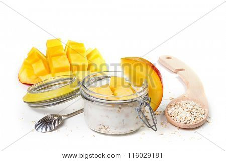 Oat flakes with yogurt and mango  isolated on a white background