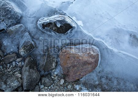 Stones Partially Covered In Ice