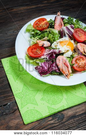 Healthy Shrimp and Arugula Salad with Tomatoes on a wooden table