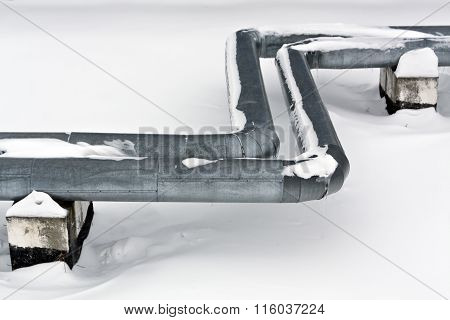 Steel Metal Tubes In Snow.
