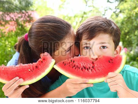 Siblings With Water Melon Slices