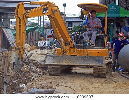 man is operating power shovel in Bangkok, Thailand