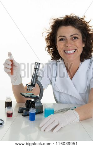 Female Scientist Studying New Substance Or Virus In Microscope