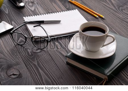 Cup Of Coffee With Notebook And Glasses