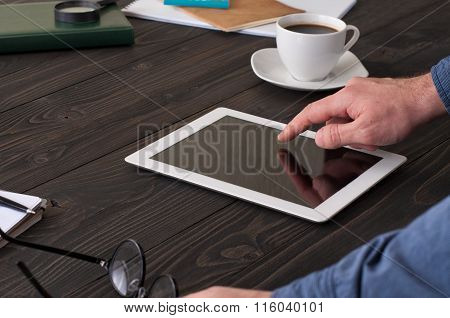 Man Working At Home Using Tablet Computer