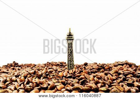 The Eiffel tower under coffee beans
