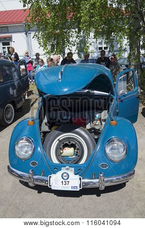 The Volkswagen beetle with the hood open at the parade-exhibition of retro cars. Savonlinna, Finland