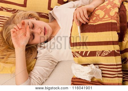 Sick Woman Lying In Bed Covered With Blanket, Feeling Ill, Has Flu And Fever.