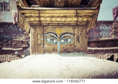 Buddha Eyes Close Up With Prayer Flags At Bodhnath Stupa In Kathmandu Valley, Nepal