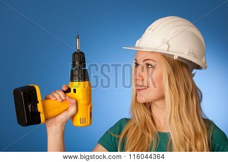 Woman With Constructor Helmet And Electric Wrench Happy To Do Tough Work.