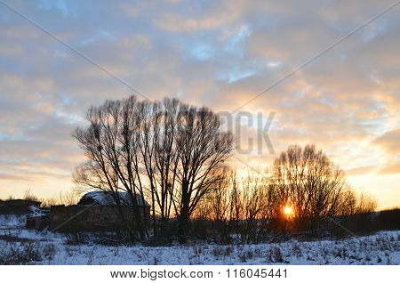 Picturesque moody sunset in the countryside in wintertime