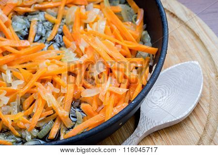Onions And Carrots In A Frying Pan.